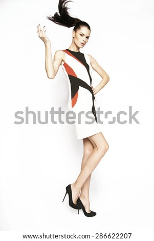 Beautiful brunette posing  in the studio,in full growth - stock photo