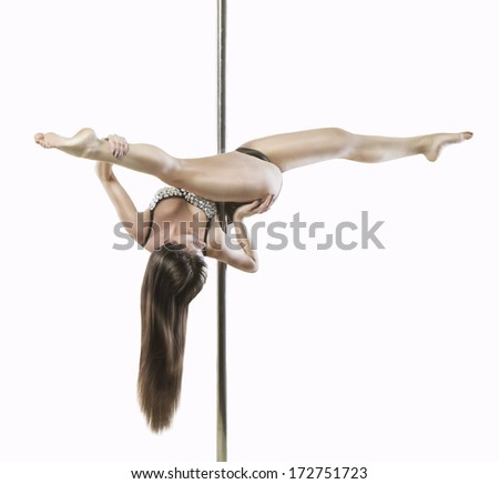 Beautiful brunette professional dancer performs poledancer acrobatics trick Split head over heels. Studio shot. white background - stock photo