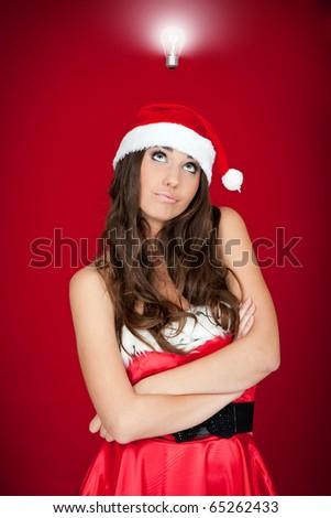 beautiful brunette santa woman with an idea - stock photo