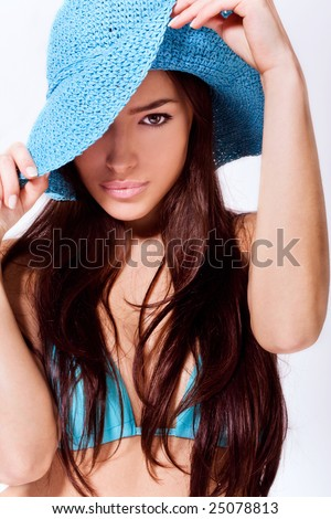 beautiful brunette wearing blue summer hat and bikini - stock photo