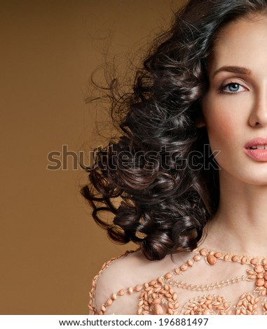 beautiful brunette with   curly hair - stock photo