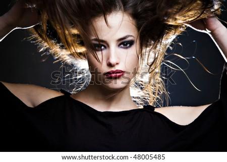 beautiful brunette with hair up, studio shot - stock photo