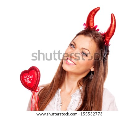Beautiful brunette with heart and red devil horns looking at camera, isolated on white - stock photo