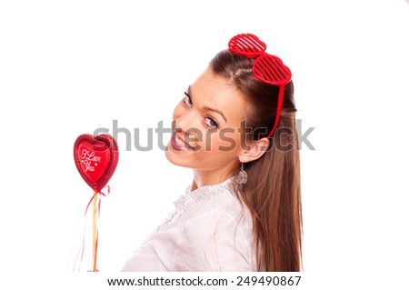 Beautiful brunette with heart shape glasses holding heart, on white background - stock photo