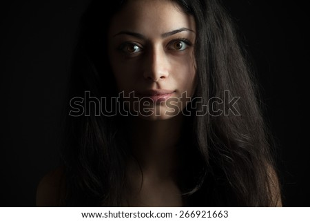 Beautiful brunette with kind eyes - stock photo