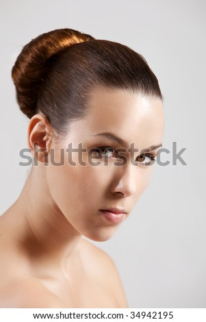 Beautiful brunette with simpel and elegant hairstyle - stock photo