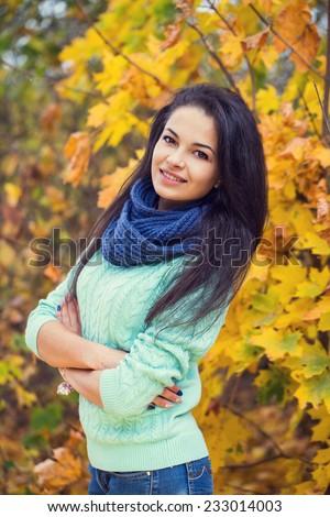 beautiful brunette woman autumn portrait blue scarf - stock photo