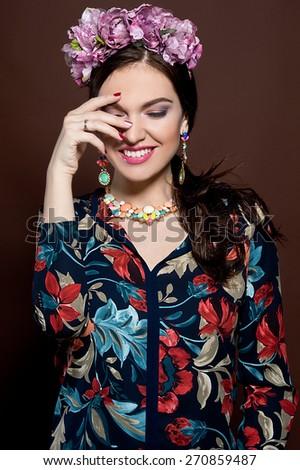 Beautiful brunette woman. Cuban beauty woman with flower wreath - stock photo