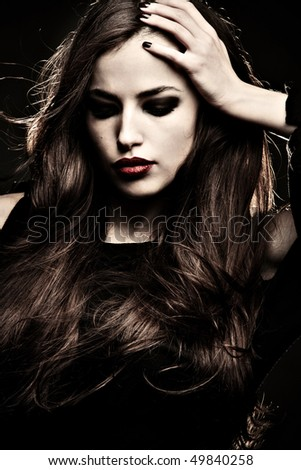 beautiful brunette  woman desaturated portrait, studio shot - stock photo