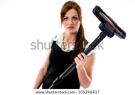 Beautiful brunette woman holding a vacuum cleaner - isolated - stock photo