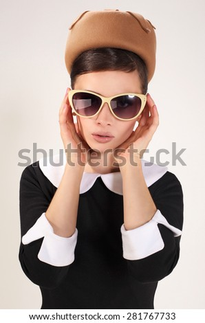 beautiful brunette woman in a retro style with sunglasses - stock photo