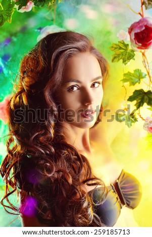 Beautiful brunette woman in bikini among tropical plants. Beauty, fashion. Spa, healthcare. Tropical vacation. - stock photo