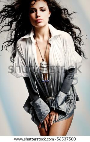 beautiful brunette woman in elegant shirt, studio shot - stock photo