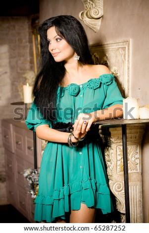 Beautiful brunette woman in interior - stock photo