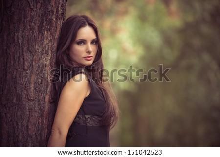 beautiful brunette woman outdoor portrait in the park - stock photo