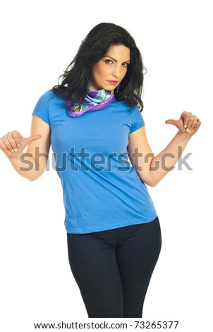 Beautiful brunette woman pointing with thumbs to her blank blue t-shirt isolated on white background - stock photo