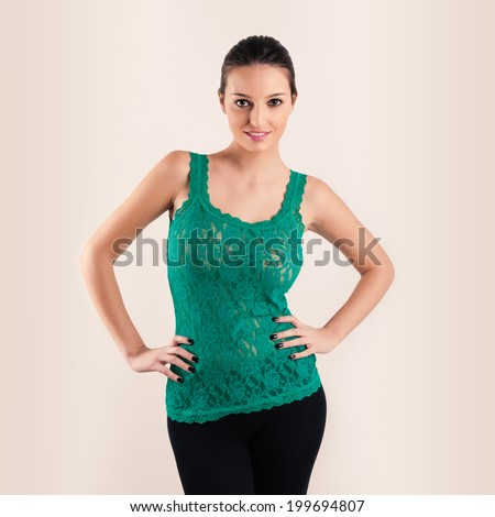 Beautiful brunette woman portrait on beige background.  - stock photo