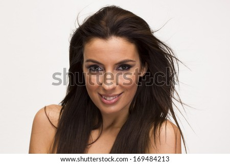 Beautiful brunette woman portrait on white isolated background - stock photo
