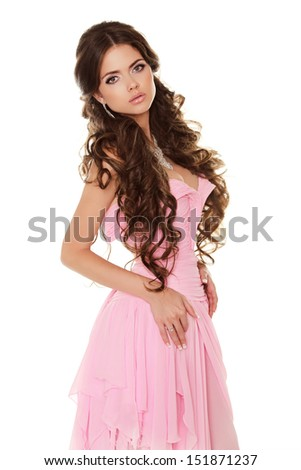 Beautiful brunette woman wearing in pink dress isolated on white background - stock photo