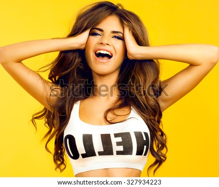 Beautiful brunette woman with a finger on her lips showing to keep silence, hush. Beauty girl with bright makeup hairstyle with horns in a blue dress having fun.White background, not isolate,screaming - stock photo