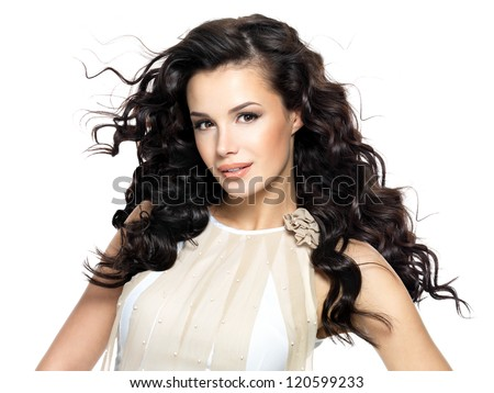 Beautiful brunette woman with beauty long curly hair. Fashion model with wavy hairstyle - stock photo