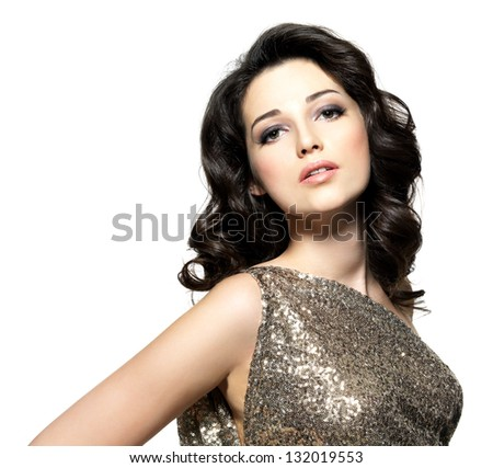 Beautiful brunette woman with fashion hairstyle poses on white background - stock photo