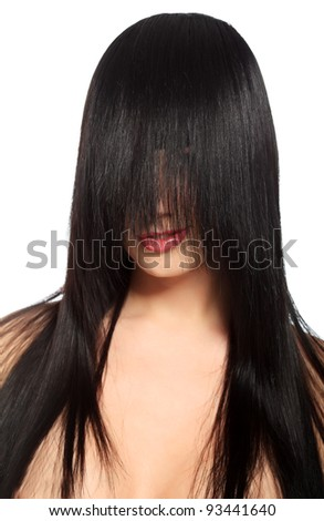 Beautiful brunette woman with hair on her face posing at studio. Isolated over white. - stock photo