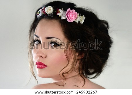 Beautiful brunette young woman with sensual look and romantic curly hairestyle. Bride. Soft makeup. - stock photo