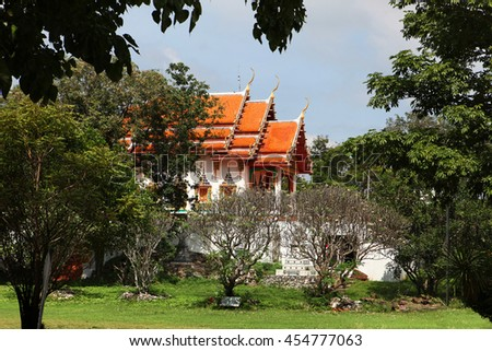 beautiful Buddhist temple gable, in forest of Thailand - stock photo