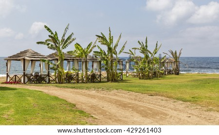 Beautiful bungalows for relaxation on the sea beach - stock photo