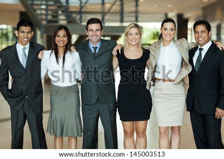 beautiful business people standing together - stock photo