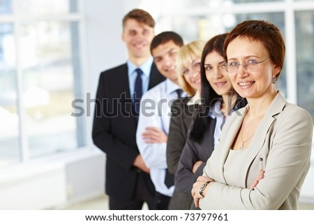 Beautiful business woman and her business team - stock photo