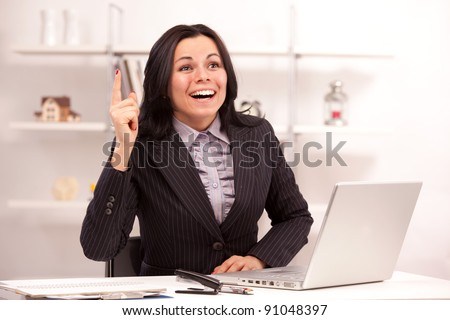 beautiful business woman at the workplace found a problem solution - stock photo