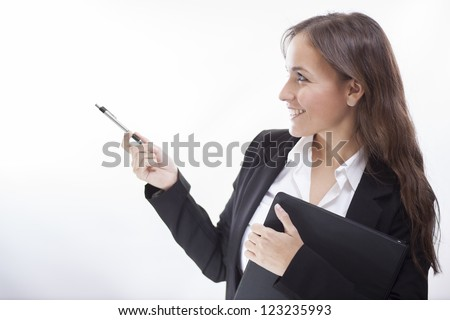 Beautiful business woman during a presentation - stock photo