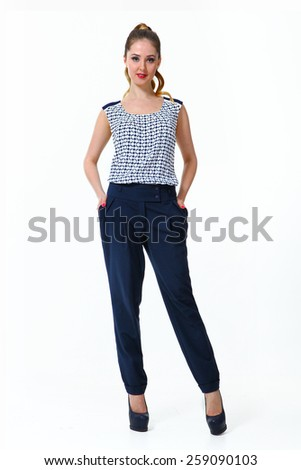 beautiful business woman fashion model girl in summer printed blouse and trousers - stock photo