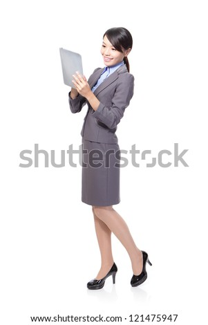 Beautiful Business woman happy using tablet PC in full length isolated on white background. young Asian woman model - stock photo