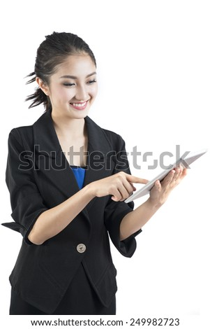 Beautiful Business woman happy using tablet PC with touchpad and smile to you isolated on white background. young Asian woman model - stock photo