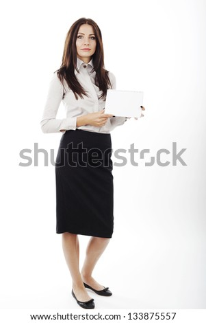 beautiful business woman holding a blank card in her hands on white background. - stock photo