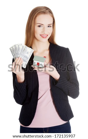 Beautiful business woman holding dollar currency and house. Isolated on white. - stock photo