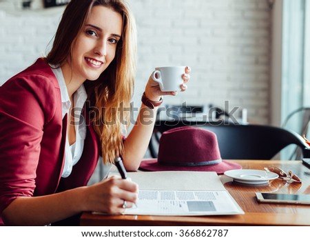 Beautiful business woman in a cafe - stock photo
