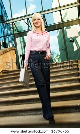 Beautiful business woman near the office building - stock photo