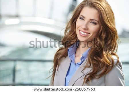 Beautiful business woman on the background of the modern office - stock photo
