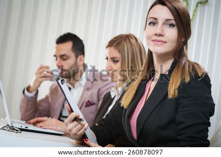 Beautiful business woman portrait, business people in office. Shallow depth of field. - stock photo