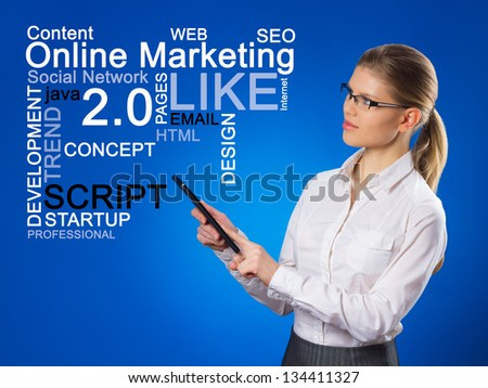 Beautiful business woman pushing SEO process. Network administrator with touchpad looking at on-line marketing chart. - stock photo
