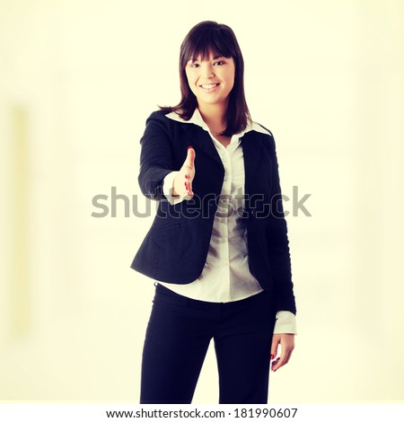 Beautiful business woman ready for hand shake - stock photo