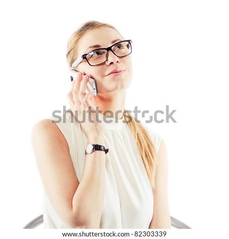 Beautiful business woman talking on the phone - stock photo