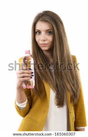 Beautiful business woman thinking about something while drinking cool fresh mineral water - stock photo