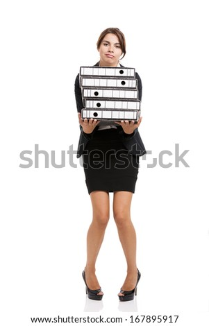 Beautiful business woman tired of work and carrying lots of folders on hands, isolated over white background - stock photo