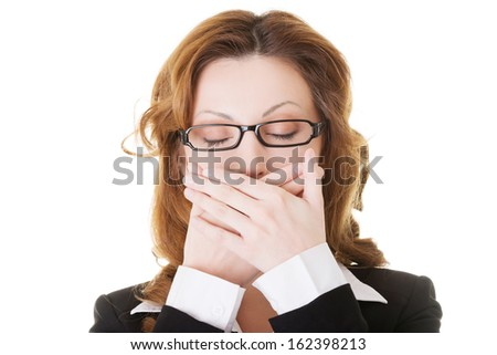 Beautiful business woman with closed eyes, covering her mouth. Isolated on white.  - stock photo