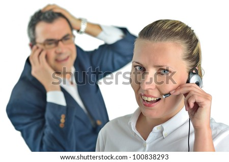 Beautiful business woman with headset and talking to a businessman - stock photo